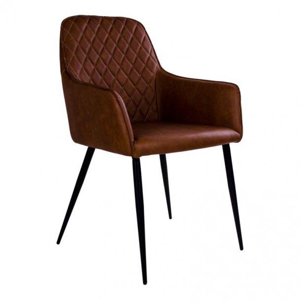 Hasse spisestuestol i vintage brun PU kunstlæder med ben i sortlakeret metal.