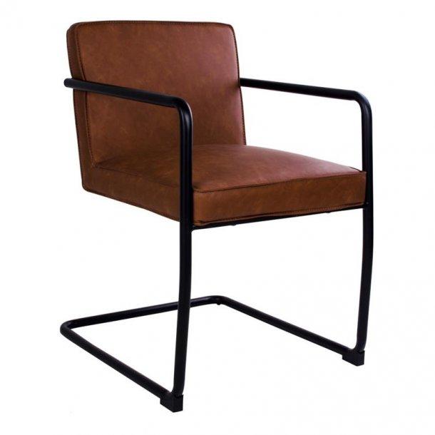Vamo spisestuestol, slædestol i brun PU kunstlæder og stel i sort.