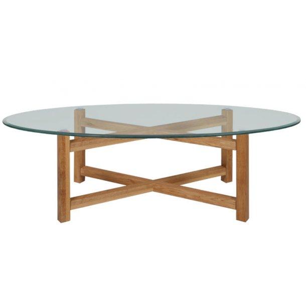 Mette sofabord 65x140 cm med glassplate med fasettslepne kanter, og stell i massiv oljebehandlet eik.