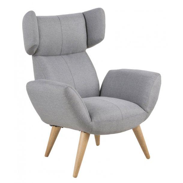Bell lænestol i lys grå Corsica stof og med ask ben oliebehandlet.