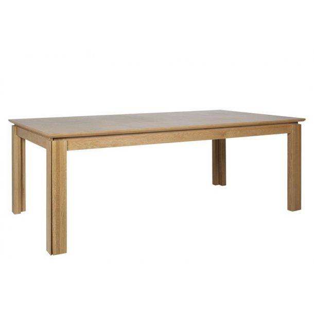 Varis spisebord med 4 udtræksplader i ege finer og massiv hvidolieret eg.