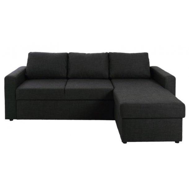 Sissel sovesofa med chaiselong vendbar med opbevaring i mørk grå.