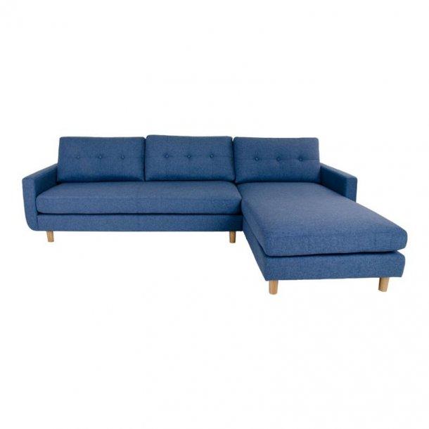 Arte sofa, chaiselongsofa højrevendt i stof blå og med træben.