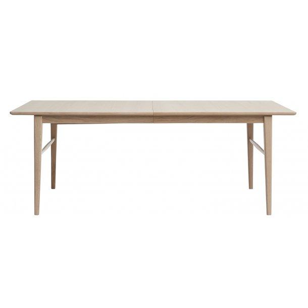 Rosie spisebord 100x205/295 cm  inkl. 2 tillægspl. i massiv og fineret amerikansk eg hvidpigm.