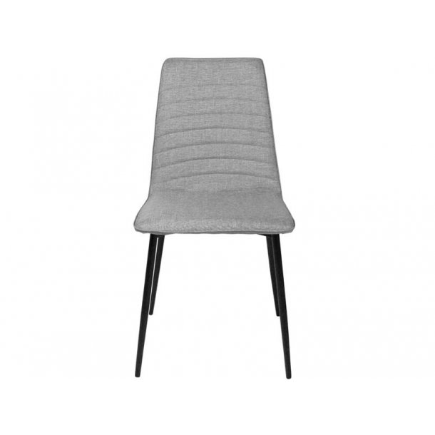 Line spisestuestol i lys grå polstret sæde og sorte metal ben.
